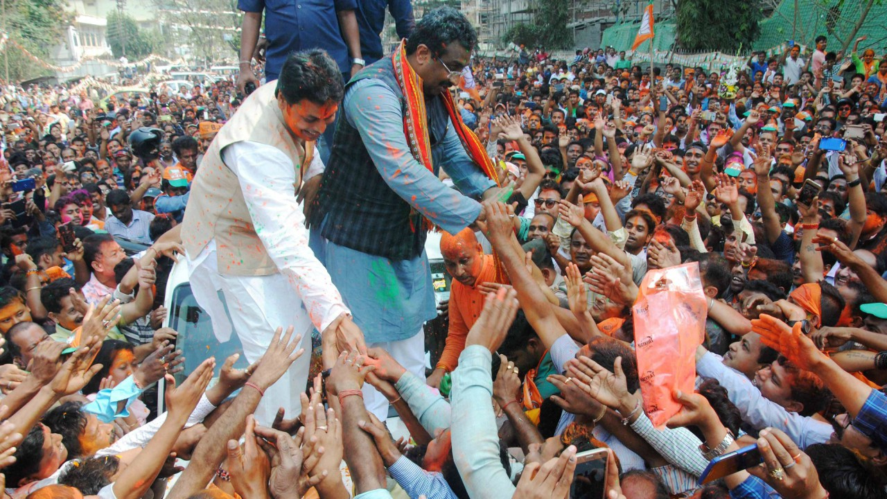 BJP National General Secretary Ram Madhav and Tripura BJP chief Biplab Kumar Deb greet the supporters after party's victory in Tripura Assembly elections results in Agartala