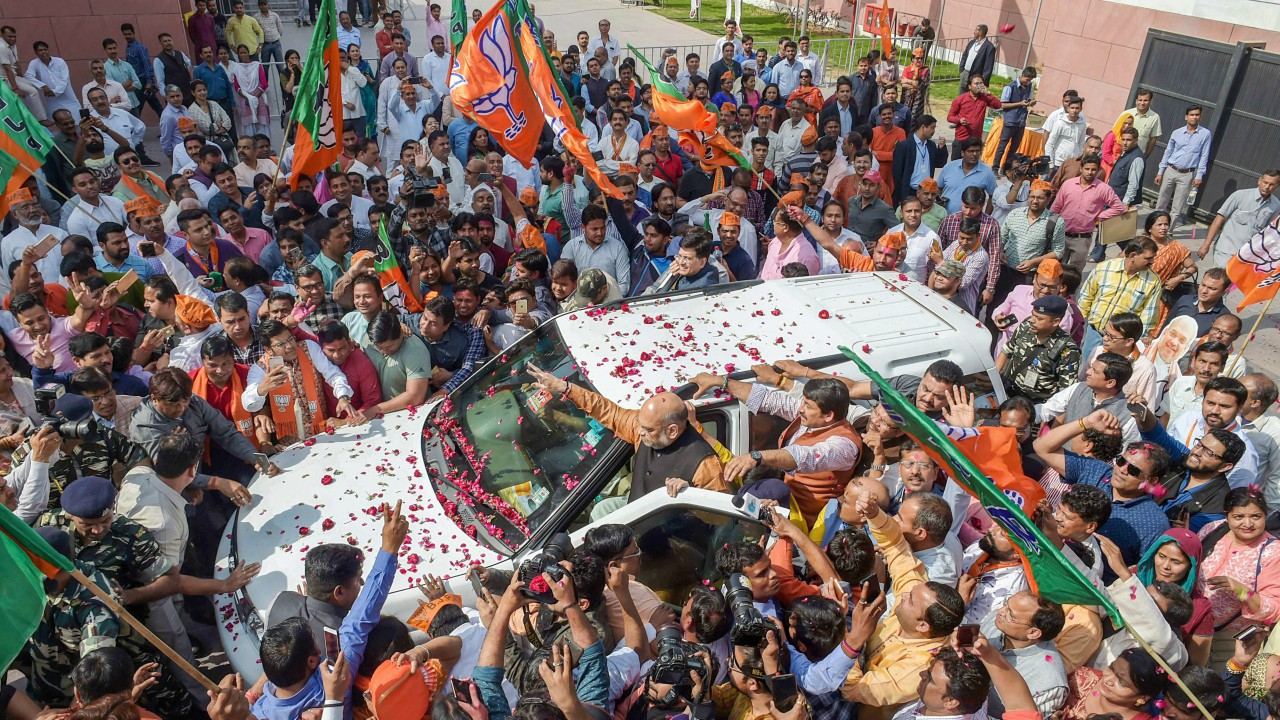 BJP party workers celebrate at party headquarters after Assembly election results, in New Delhi. (PTI)
