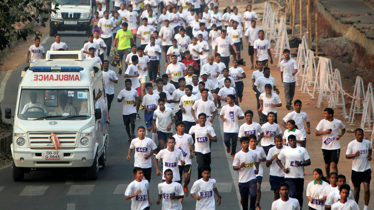 Competitors run the half marathon to mark the 102nd birth anniversary of former Orissa Chief Minister Biju Patnaik, in Bhubaneswar. (PTI)