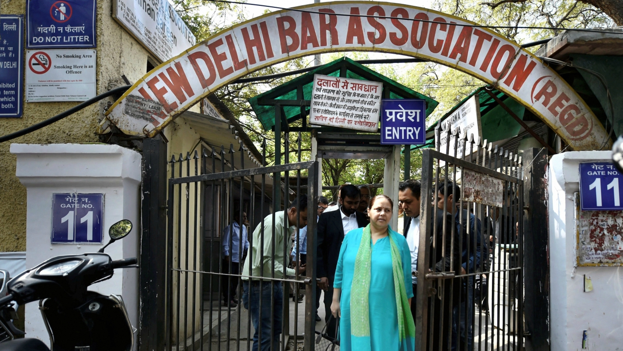 RJD chief Lalu Prasad's daughter Misa Bharti and her husband Shailesh Kumar leave the Patiala house courts after getting bail in the money laundering case, in New Delhi. (PTI)