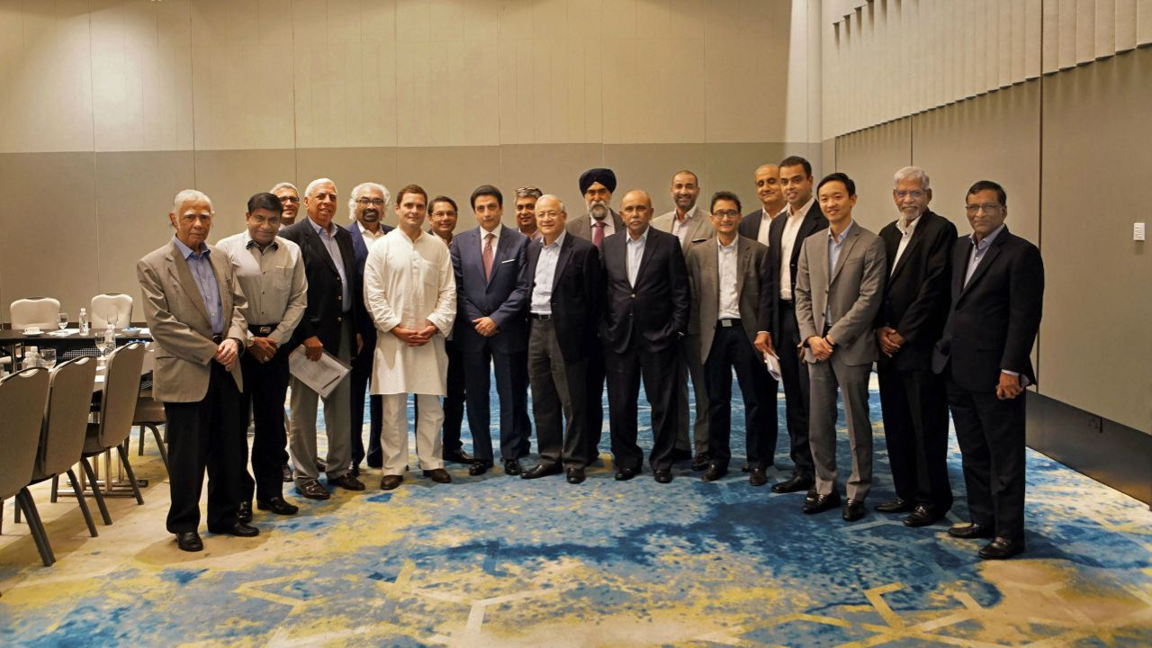 Congress President Rahul Gandhi poses for a photograph with Indian-origin CEOs of Singaporean companies, in Singapore. (PTI)