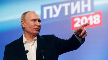 Putin says oil at $70 per barrel 'suits' Russia