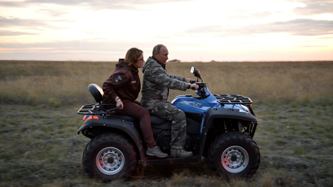Russian President Vladimir Putin drives a quad bike as he visits a reserve for Przewalski's horses outside Orenburg, Russia. (Reuters)
