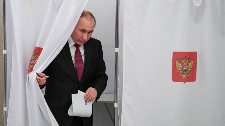 Russian President Vladimir Putin is seen at a polling station during the presidential election in Moscow, Russia. (Reuters)
