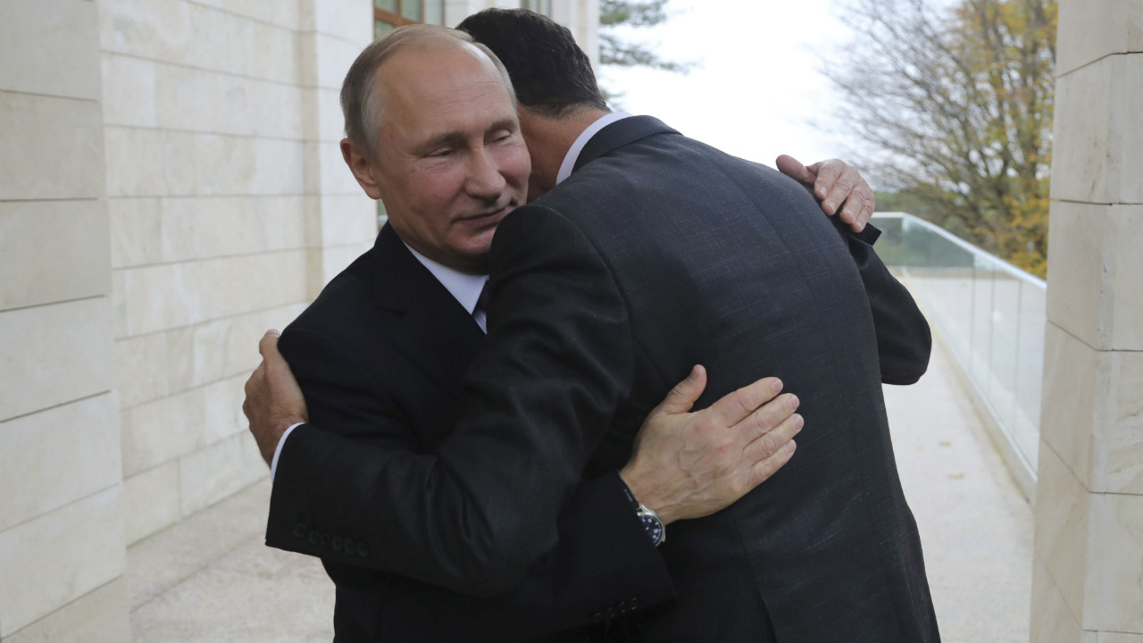 Russian President Vladimir Putin (L) welcomes Syrian President Bashar al-Assad during a meeting in the Black Sea resort of Sochi, Russia. (Reuters)