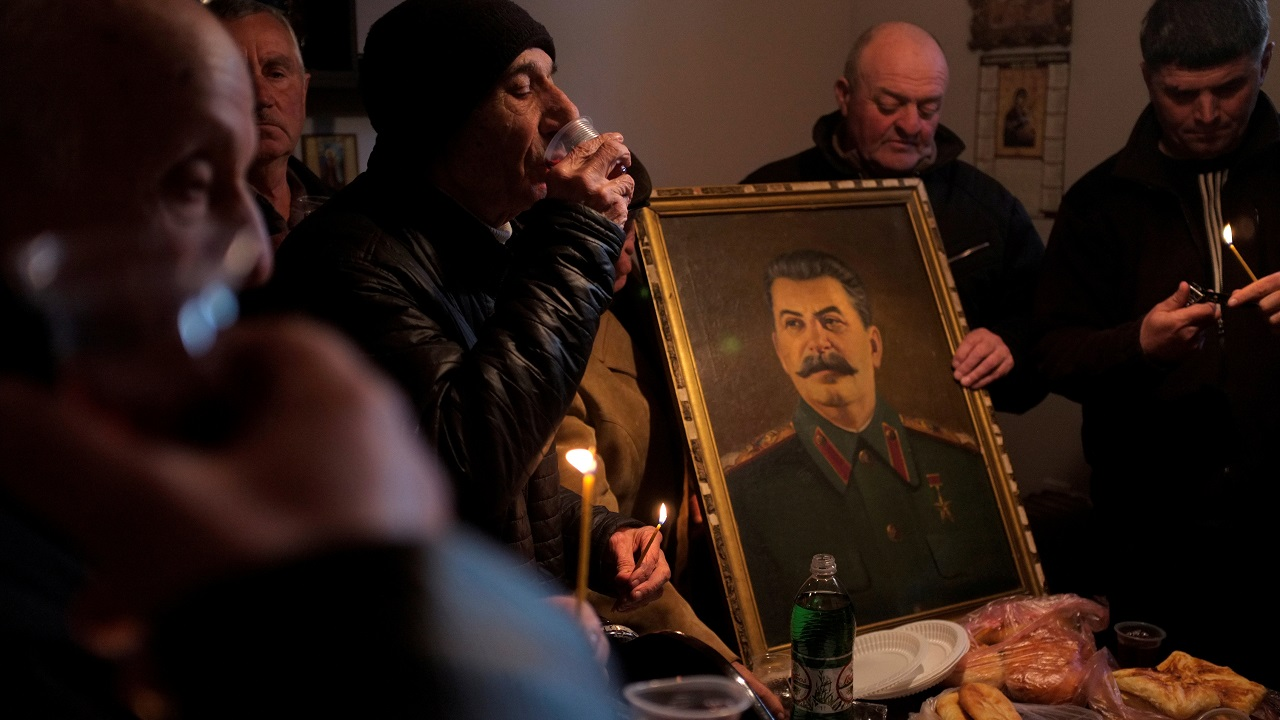 People drink wine during a gathering to mark the anniversary of Soviet leader Joseph Stalin's death in his hometown of Gori, Georgia. (Reuters)