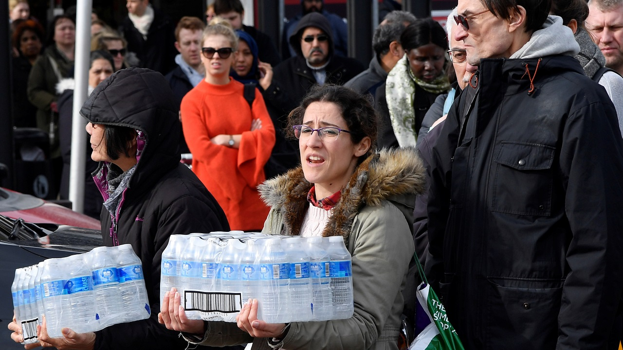Local residents collect bottled water distributed by Thames Water after mains supplies to homes were cut off following bad weather, in Balham, south London. (Reuters)