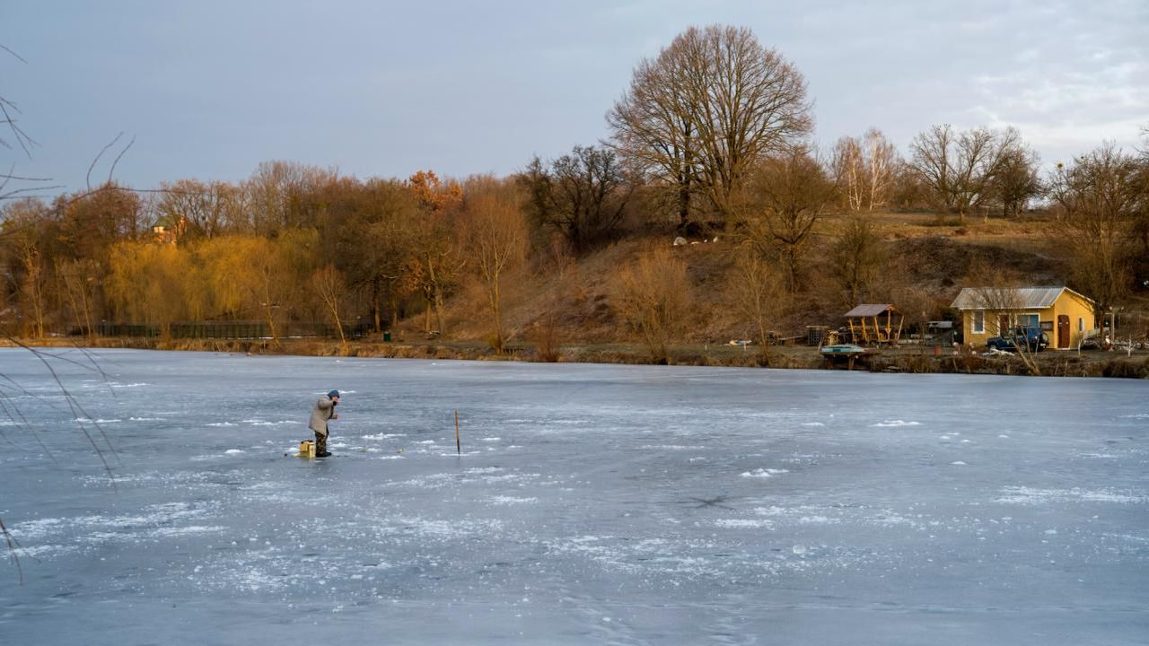 A man fishes in a frozen lake in the village of Ivankovichy, Ukraine. (Reuters)