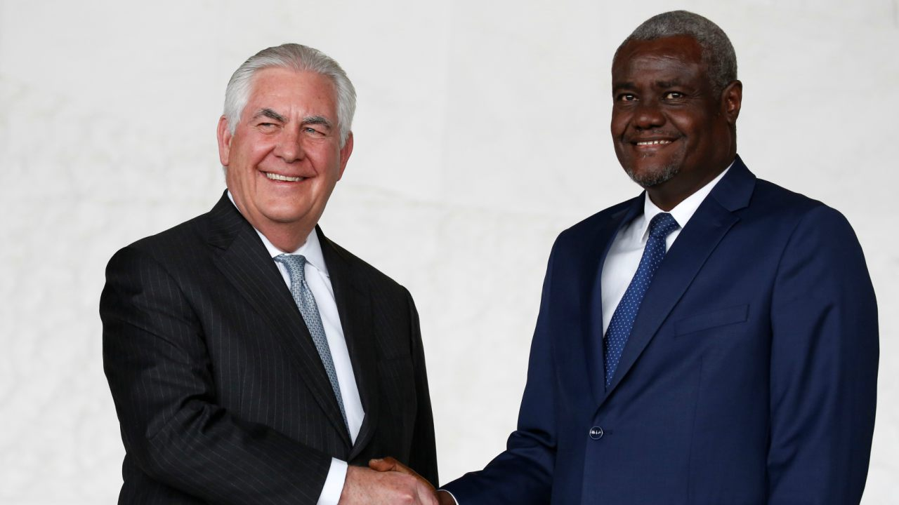 African Union (AU) Commission Chairman Moussa Faki, of Chad, and U.S. Secretary of State Rex Tillerson smile and shake hands for news photographers after their meeting at AU headquarters in Addis Ababa, Ethiopia. (Reuters)