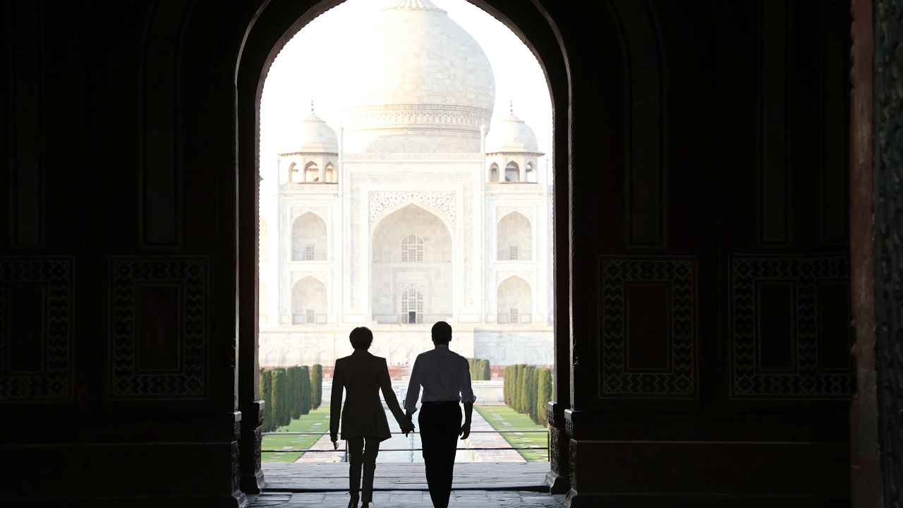 French President Emmanuel Macron and his wife Brigitte Macron are seen at the Taj Mahal in Agra. (Reuters)