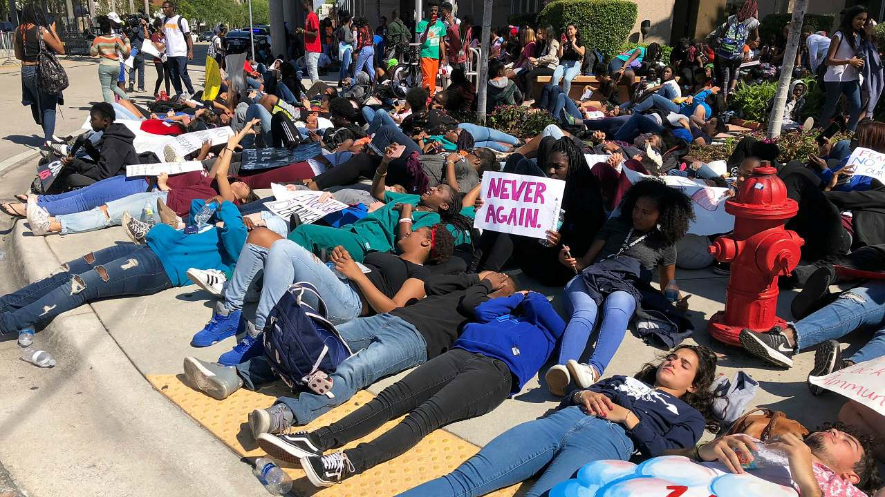 Students from Broward County high schools stage a die-in on a sidewalk in downtown Fort Lauderdale, Florida. (Reuters)