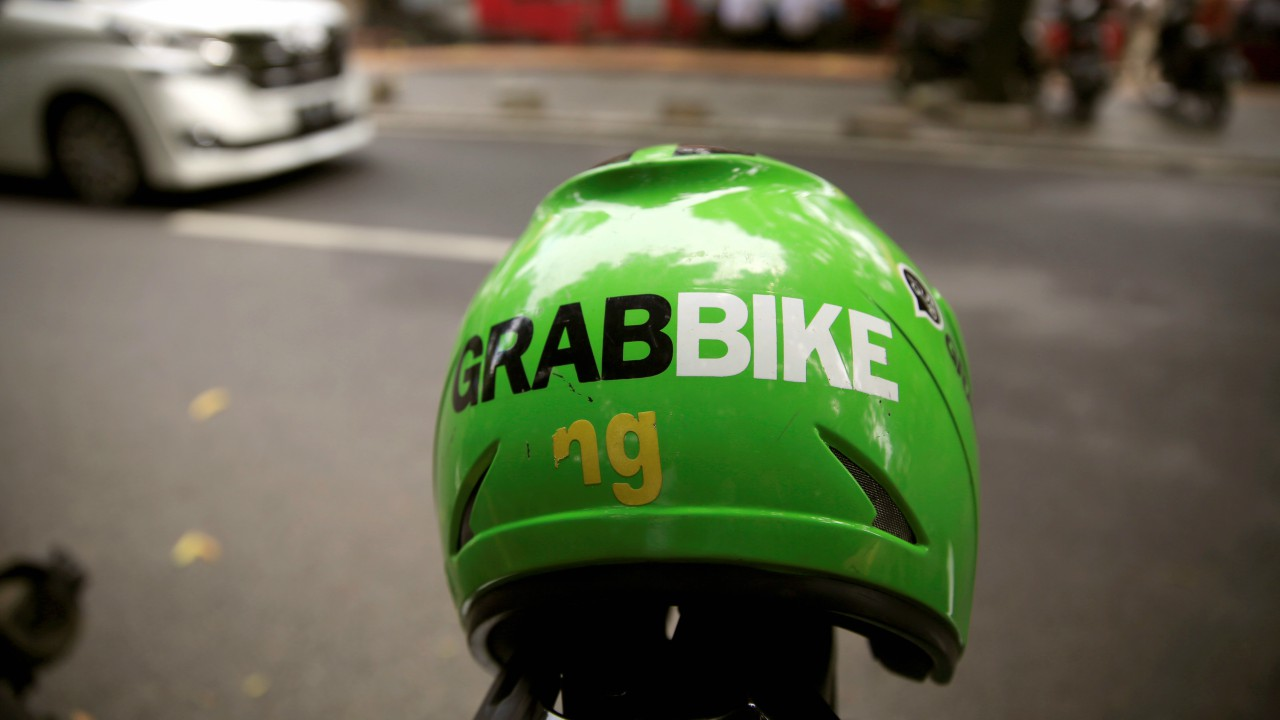 A Grab bike helmet is seen near Sudirman train station in Jakarta, Indonesia, March 26, 2018. Uber is reported to have sold off its southeast asia operations to the company today.(REUTERS)
