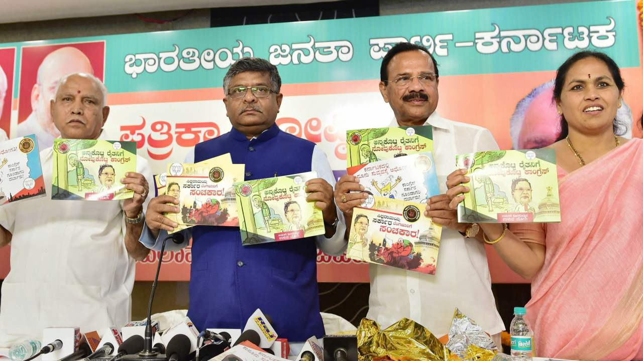 Union ministers Ravi Shankar Prasad, Sadananda Gowda BJP Karnataka unit President B S Yeddyurappa and MP Shobha Karandlaje releasing a booklet of charges against Congress government in the State in Bengaluru on 1st April 2018