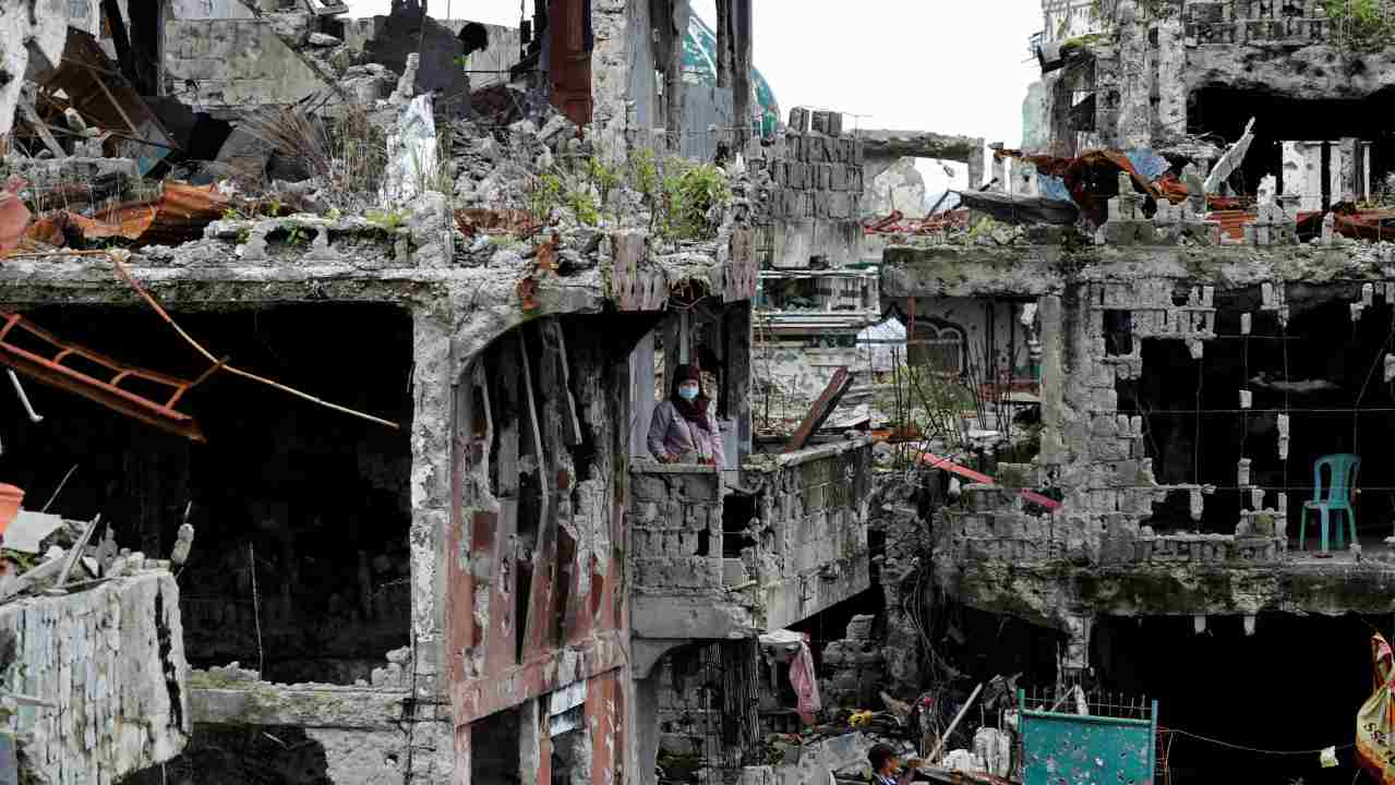 A woman stands at her ruined house, after residents were allowed to return to their homes for the first time since the battle between government troops and Islamic State militants began on May 2017, at the Islamic city of Marawi, Philippines. (REUTERS)