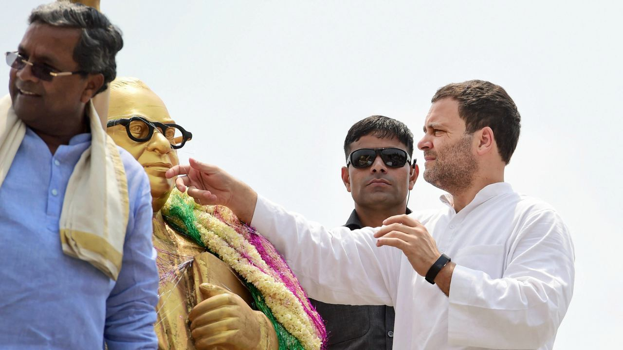 Congress President Rahul Gandhi paying homage to BR Ambedkar ahead of Karnataka Assembly elections in Kolar on 7th April 2018. (PTI Photo)
