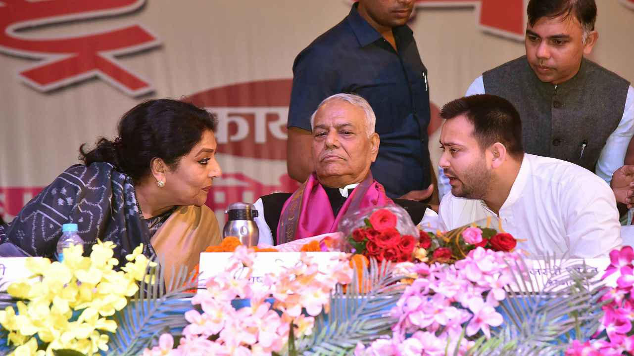 Former Union Finance Minister Yashwant Sinha with RJD leader and former Deputy Chief Minister of Bihar Tejaswi Yadav and Congress leader Renuka Chowdhary during 'Rashtra Manch' meeting at Shri Krishna Memorial Hall in Patna. (PTI)
