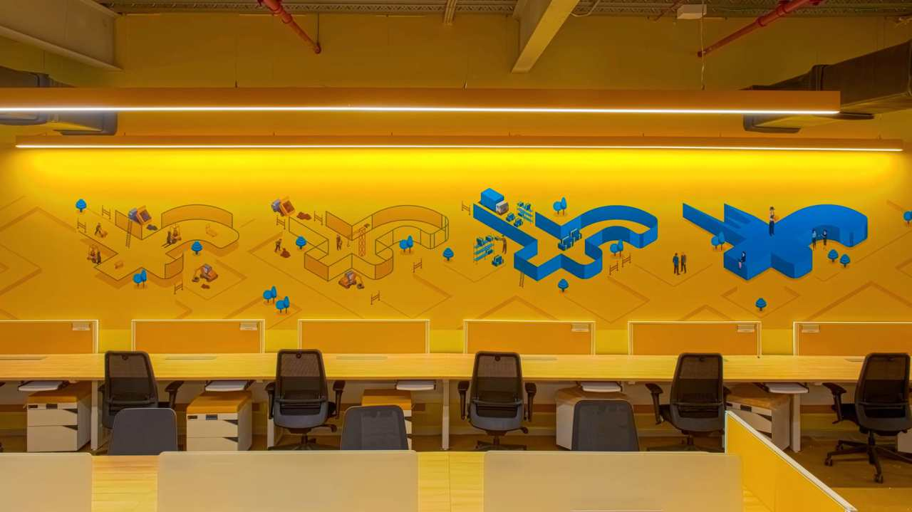 The interiors of the Flipkart headquarters are splashed in vibrant and bright colours adorned with various graffiti and murals.
