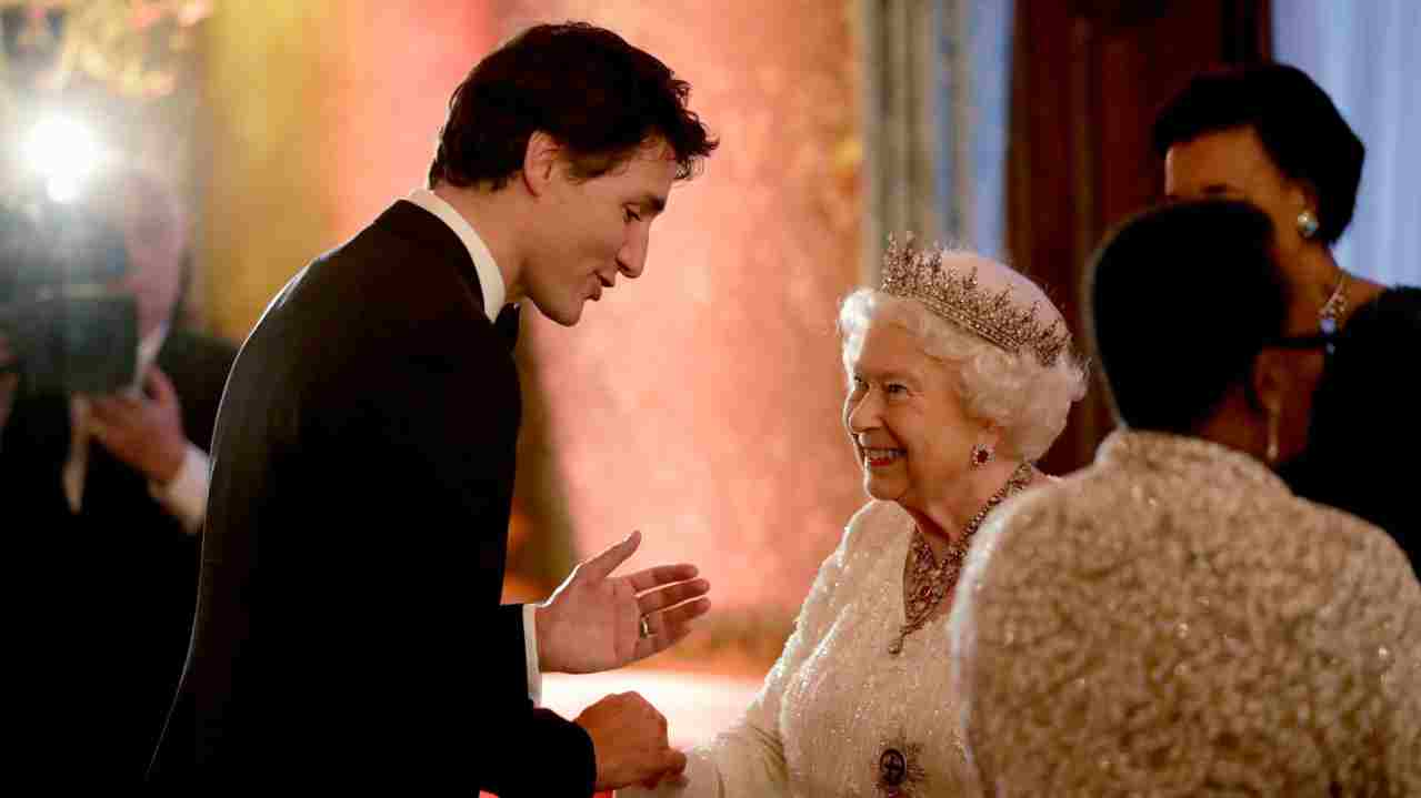 Britain's Queen Elizabeth II greets Canadian Prime Minister Justin Trudeau in a receiving line for the Queen's Dinner for the Commonwealth Heads of Government Meeting (CHOGM) at Buckingham Palace in London. (REUTERS)