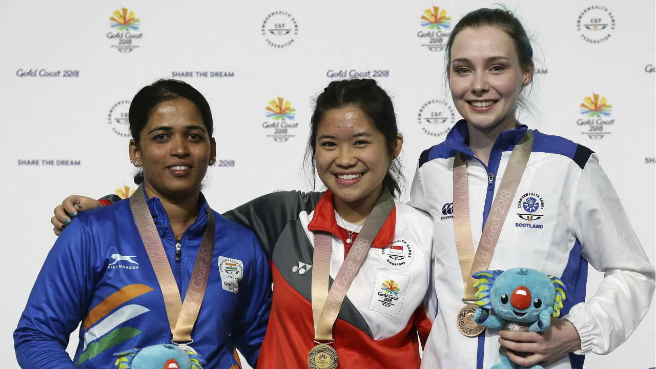 Tejaswini Sawant of India, left, silver medal, Martina Lindsay Veloso of Singapore, center, gold medal, and Seonaid McIntosh of Scotland, right, bronze medal, stand on the podium during the women's 50m Rifle Prone final at the Belmont Shooting Centre during the 2018 Commonwealth Games in Brisbane, Australia. (Image: PTI)