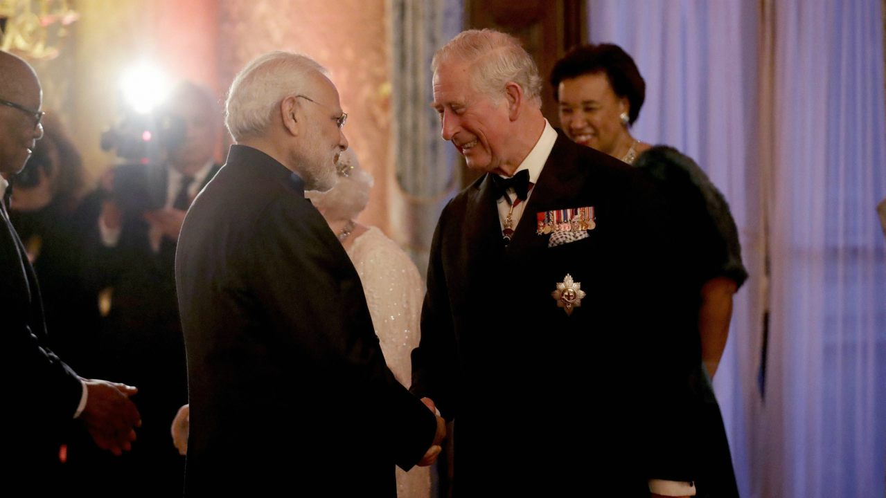 Britain's Prince Charles, right, greets India's Prime Narendra Modi in a receiving line for the Queen's Dinner for the Commonwealth Heads of Government Meeting (CHOGM) at Buckingham Palace in London. (Image: AP/PTI)