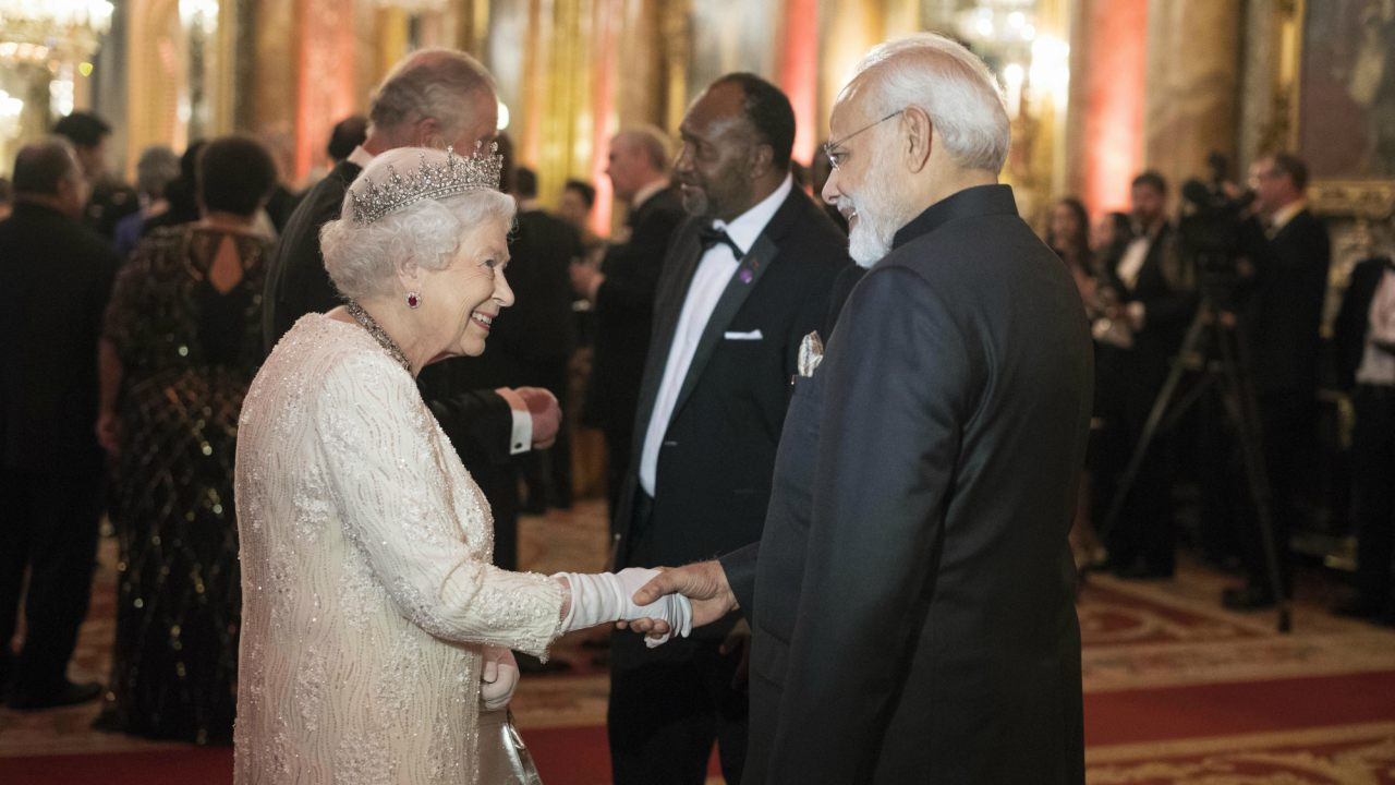 Britain's Queen Elizabeth II, greets India's Prime Minister Narendra Modi in the Blue Drawing Room at Buckingham Palace as the Queen hosts a dinner during the Commonwealth Heads of Government Meeting, in London. (Image: AP/PTI)