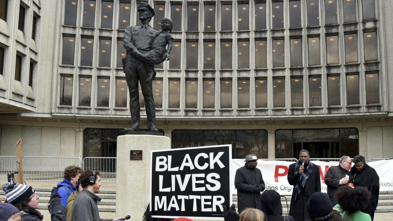 Protesters organized by the interfaith group POWER convene outside Philadelphia Police Department headquarters before marching to City Hall, Thursday, April 19, 2018, to rally against the decision of officers to arrest two black men at a Center City Starbucks last week. (Image: AP/PTI)