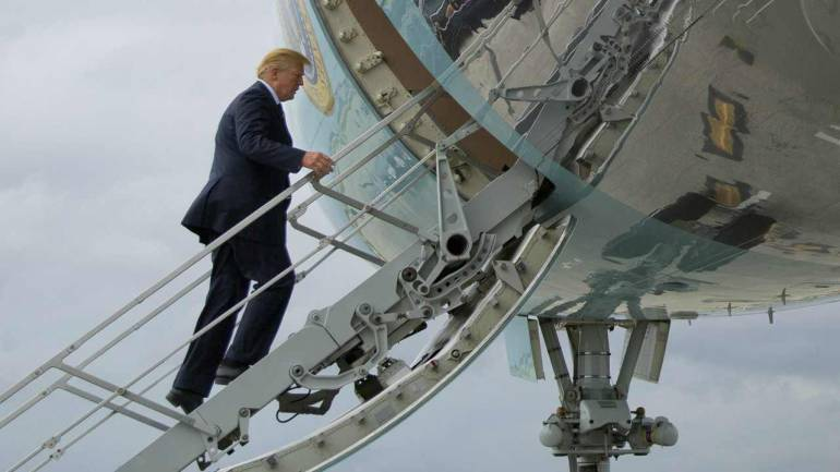 U.S. President Donald Trump boards Air Force One during his departure from Palm Beach International Airport in West Palm Beach, Florida. (AP/PTI)