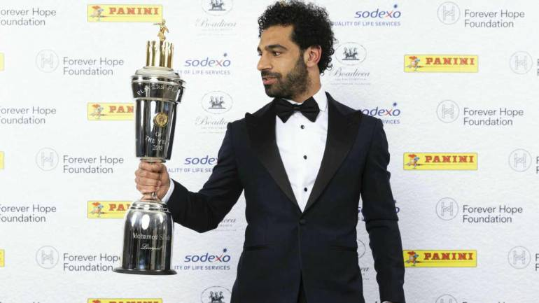 Liverpool soccer player Mohamed Salah poses with the PFA Player Of The Year Award Trophy during the 2018 PFA Awards at the Grosvenor House Hotel, London. Salah has been voted player of the year by his fellow professionals in English soccer in recognition of an incredible scoring return to the Premier League with Liverpool. (AP/PTI)