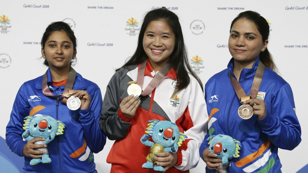Mehuli Gosh of India, left, silver medal, Lindsay Martina Veloso of Singapore, center, gold medal, and Chandela Apurvi of India, right, bronze medal, in the women's 10m Air Rifle at the Belmont Shooting Centre during the 2018 Commonwealth Games in Brisbane, Australia. (Image: AP/PTI)