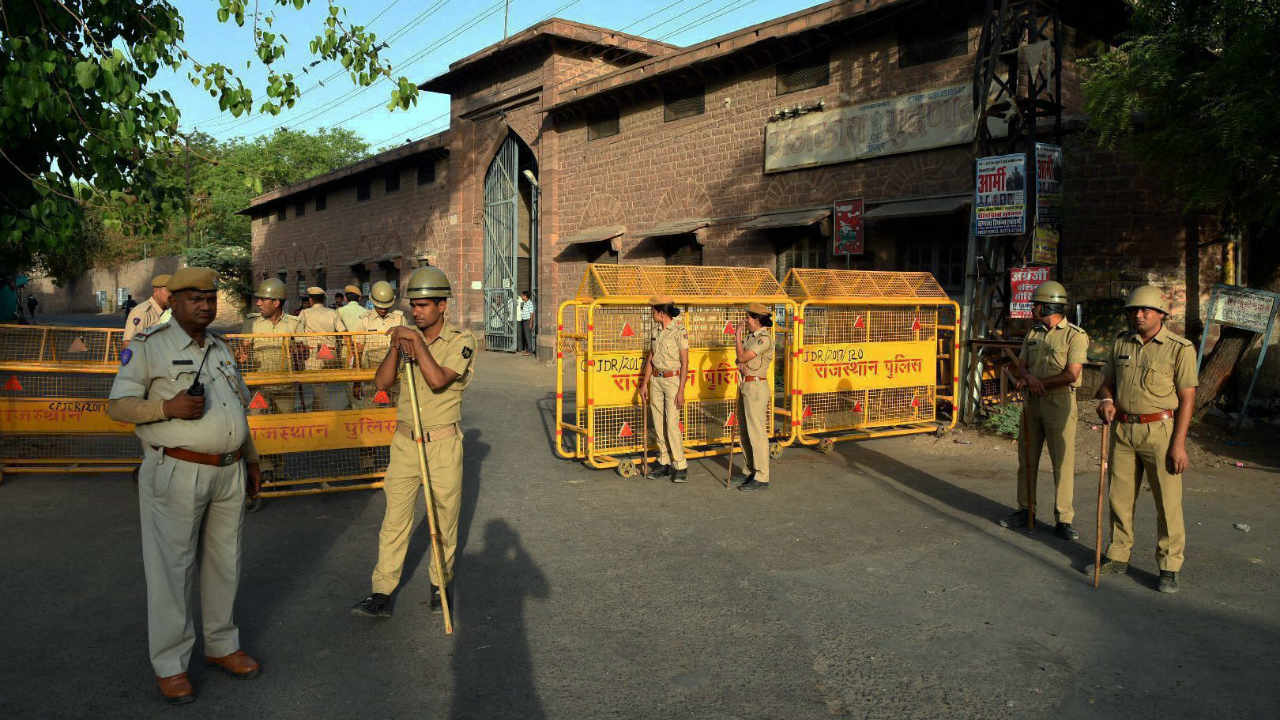 Security personnel stand guard outside Central Jail ahead of the trial court verdict in the rape case against self-styled godman Asaram in Jodhpur on Wednesday. (PTI)