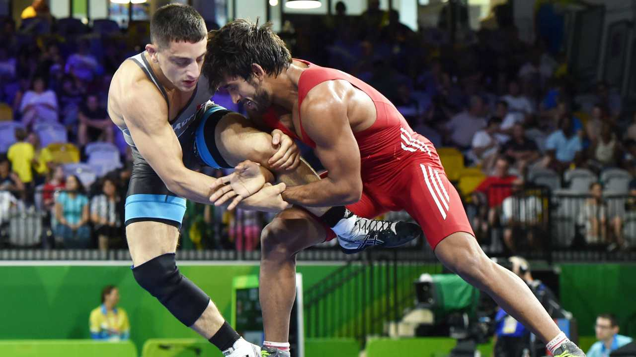 Bajrang Punia | After winning three consecutive gold medals in international events this year, the 24-year-old wrestler enters the 65 kg category as one of the pre-tournament favourites. A silver medalist at the previous Asian games, Bajrang will be looking to go one better this time around, under the able mentorship of his mentor, Olympic bronze medalist Yogeshwar Dutt. (Image – PTI)