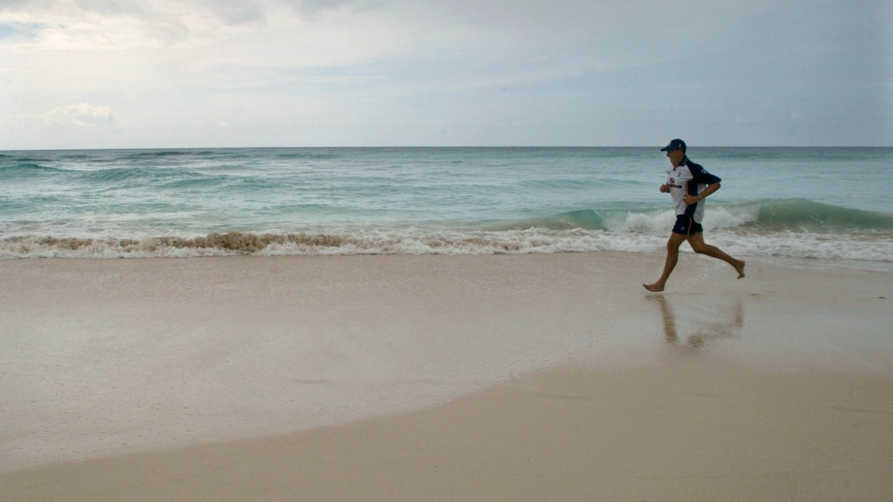 Barbados | Cost per litre - Rs 134.13 | A man is seen running on a beach in Barbados. (Image: Reuters)