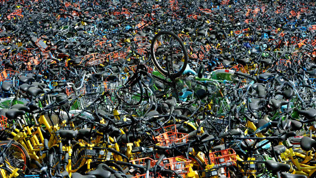 Bicycles of various bike-sharing services are seen at a vacant lot in Wuhan, Hubei province, China. (Photo: Reuters)