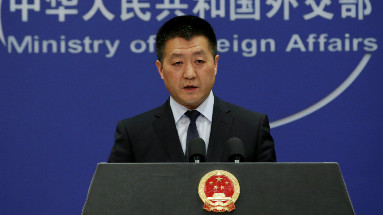 Chinese Foreign Ministry spokesman Lu Kang answers questions about a major bus accident in North Korea, during a news conference in Beijing, China. (Reuters)