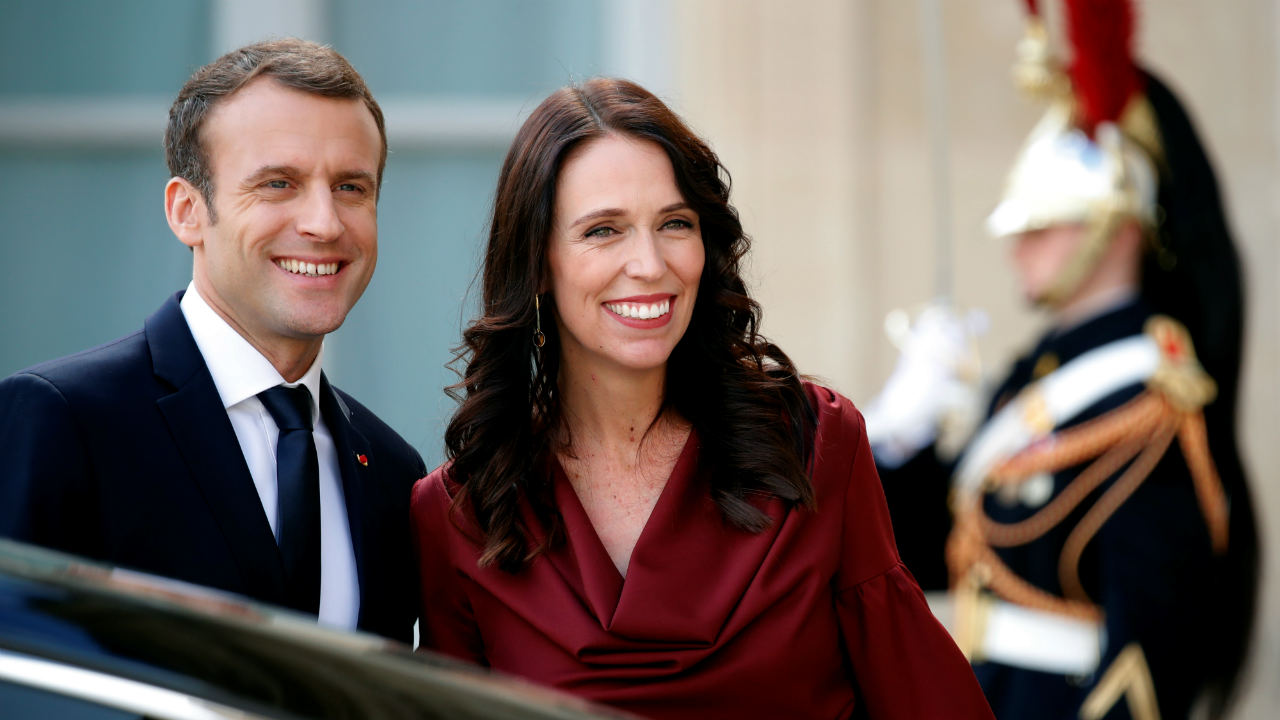French President Emmanuel Macron poses next to New Zealand Prime Minister Jacinda Ardern as she leaves the Elysee Palace in Paris, France. (Photo: Reuters)