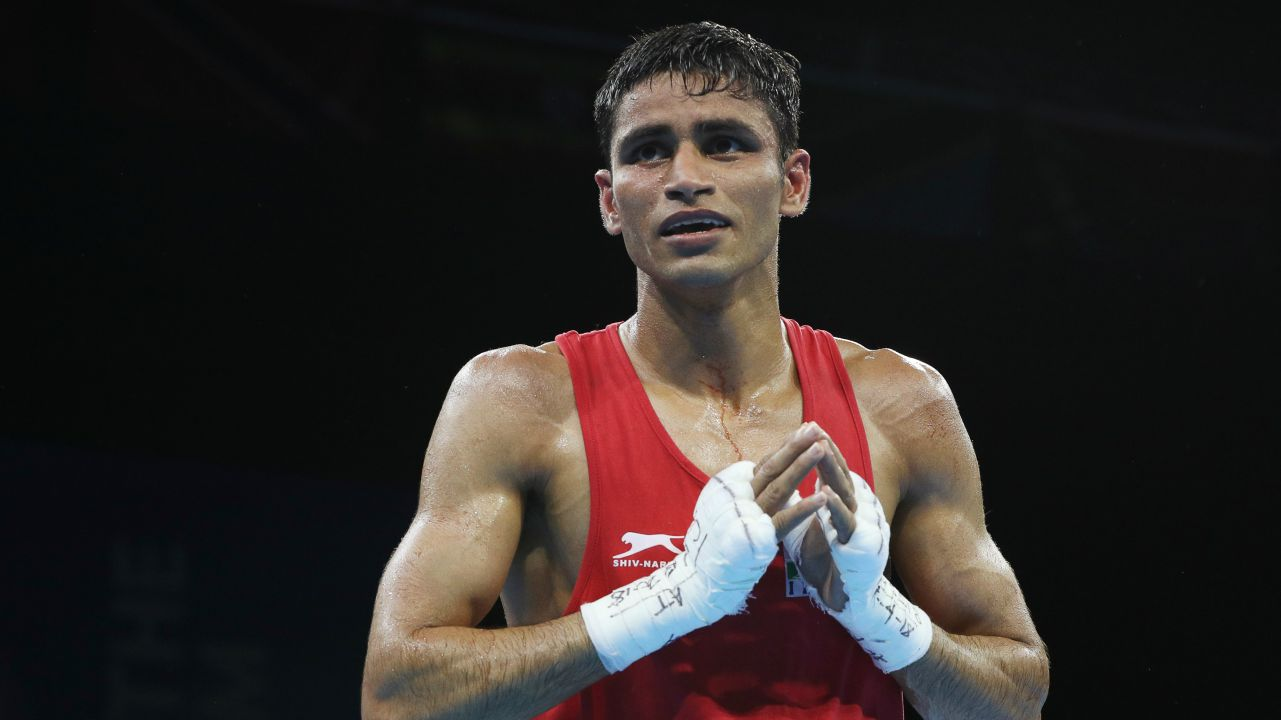 Gaurav Solanki | Indian boxer Gaurav Solanki wins a gold medal in men's 52 kg boxing event after defeating Northern Ireland's Brendan Irvine in the finals. (Image: Reuters)