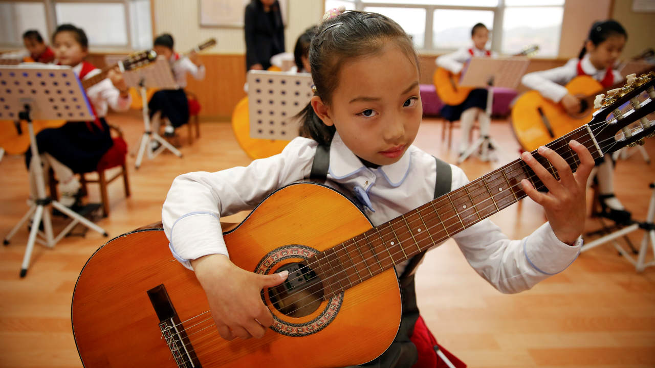 Girls play guitars at the Mangyongdae Children's Palace in Pyongyang. (Photo: Reuters)