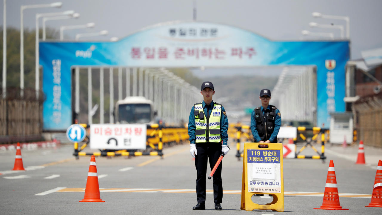 Policemen stand guard on the Grand Unification Bridge which leads to the Peace House, the venue for the inter-Korean summit, near the demilitarized zone separating the two Koreas in Paju, South Korea. (Reuters)