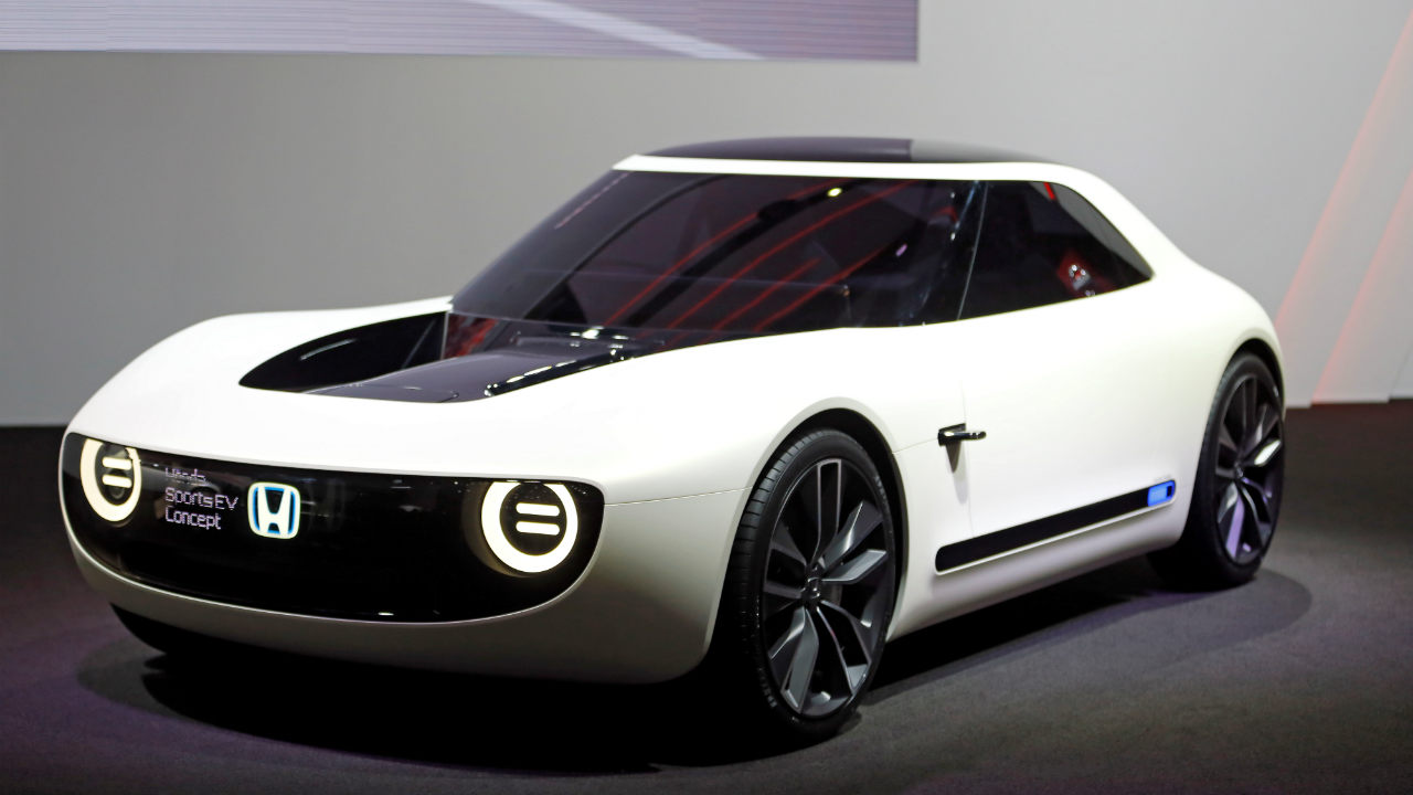 Honda Sport EV | This new sport electric vehicle concept resembles the 1973 Civic hatchback. The vehicle has a traditional long-hood, short-rear-deck design. Sports EV uses Honda's dedicated platform that developed for its future electric cars. The Japanese car maker had unveiled the car earlier at the 2017 Tokyo auto show. (Image: Reuters)