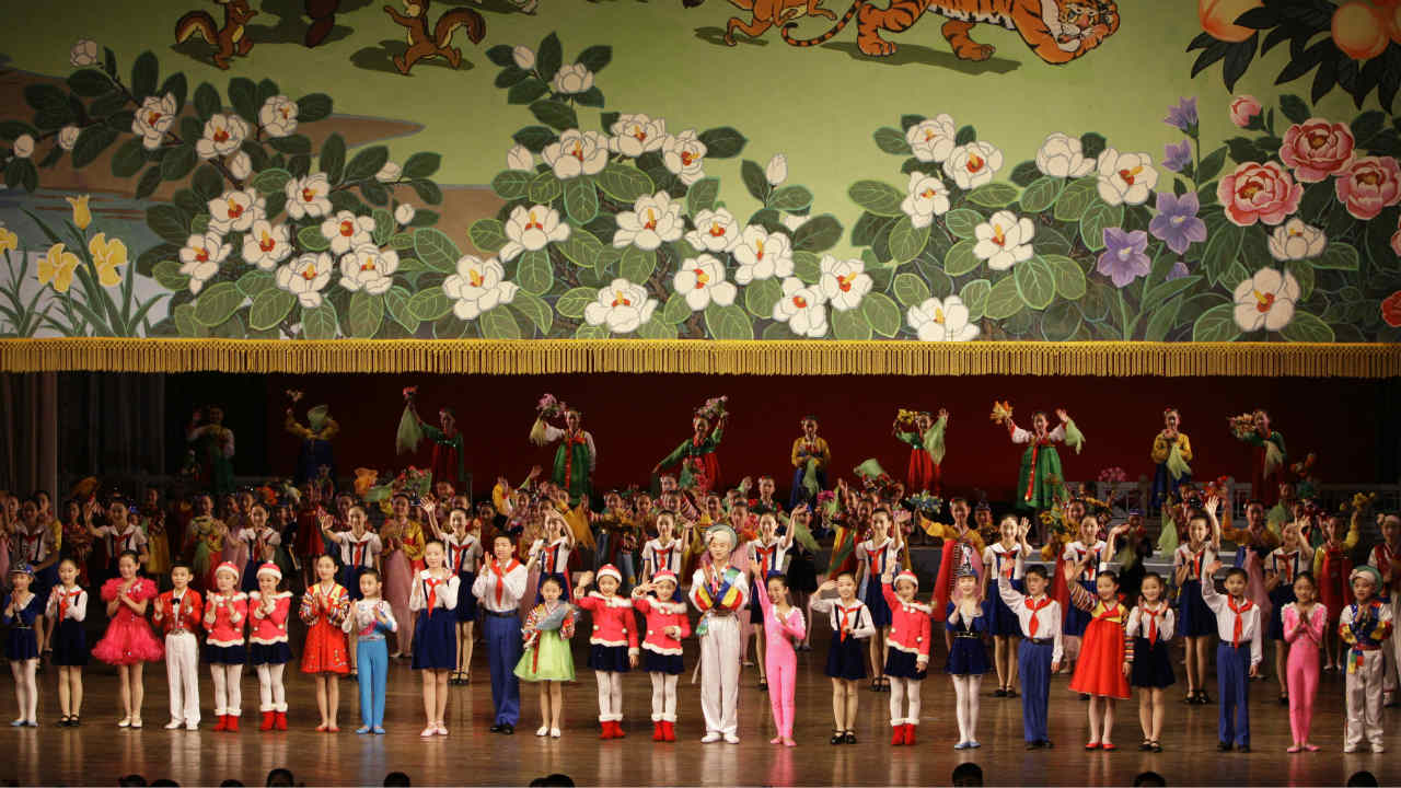 Children from North Korea's elite performing arts school wave to the audience at the Mangyongdae Schoolchildren's Palace in Pyongyang. (Photo: Reuters)