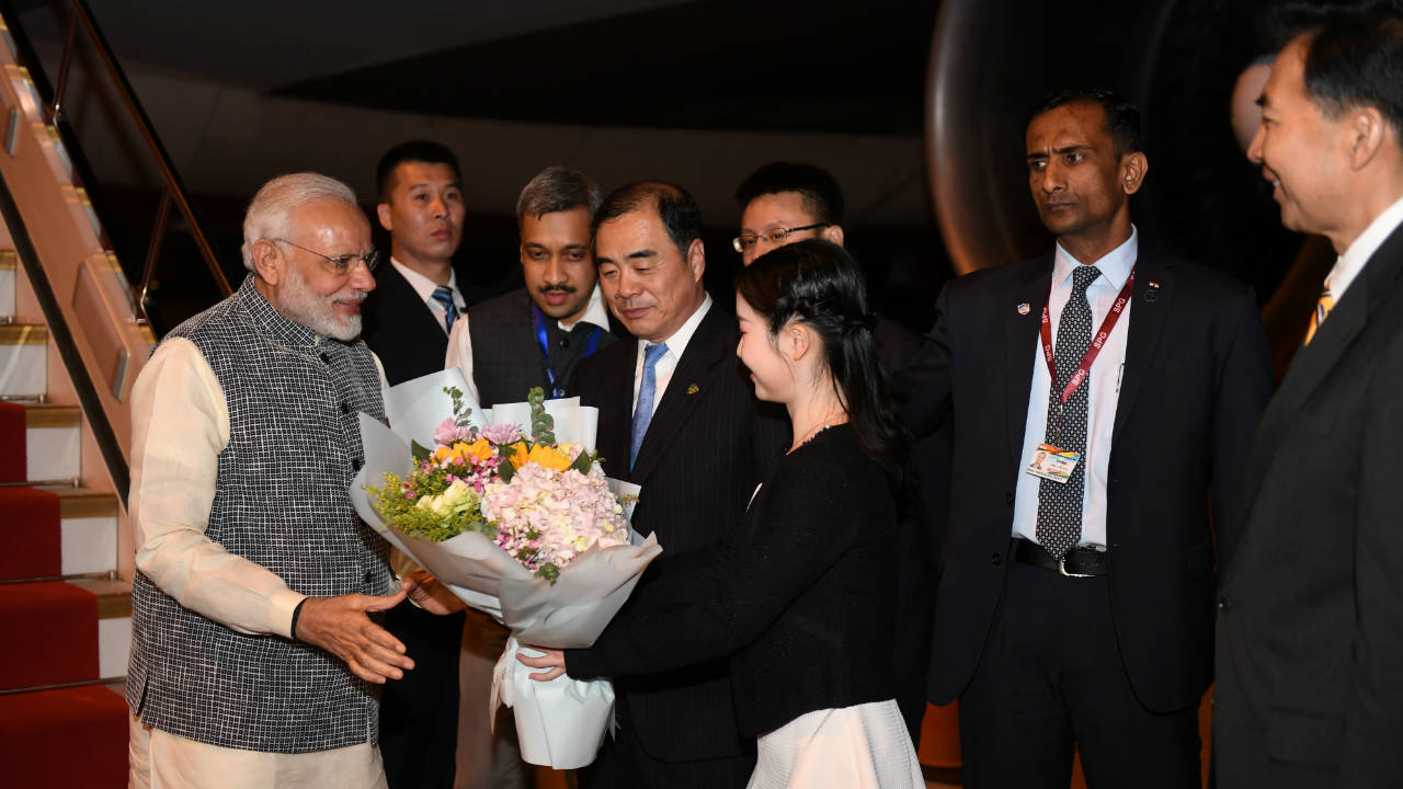 Prime Minister Narendra Modi is greeted by Chinese officials as he arrives at the airport in Wuhan, Hubei province, China. (Reuters)