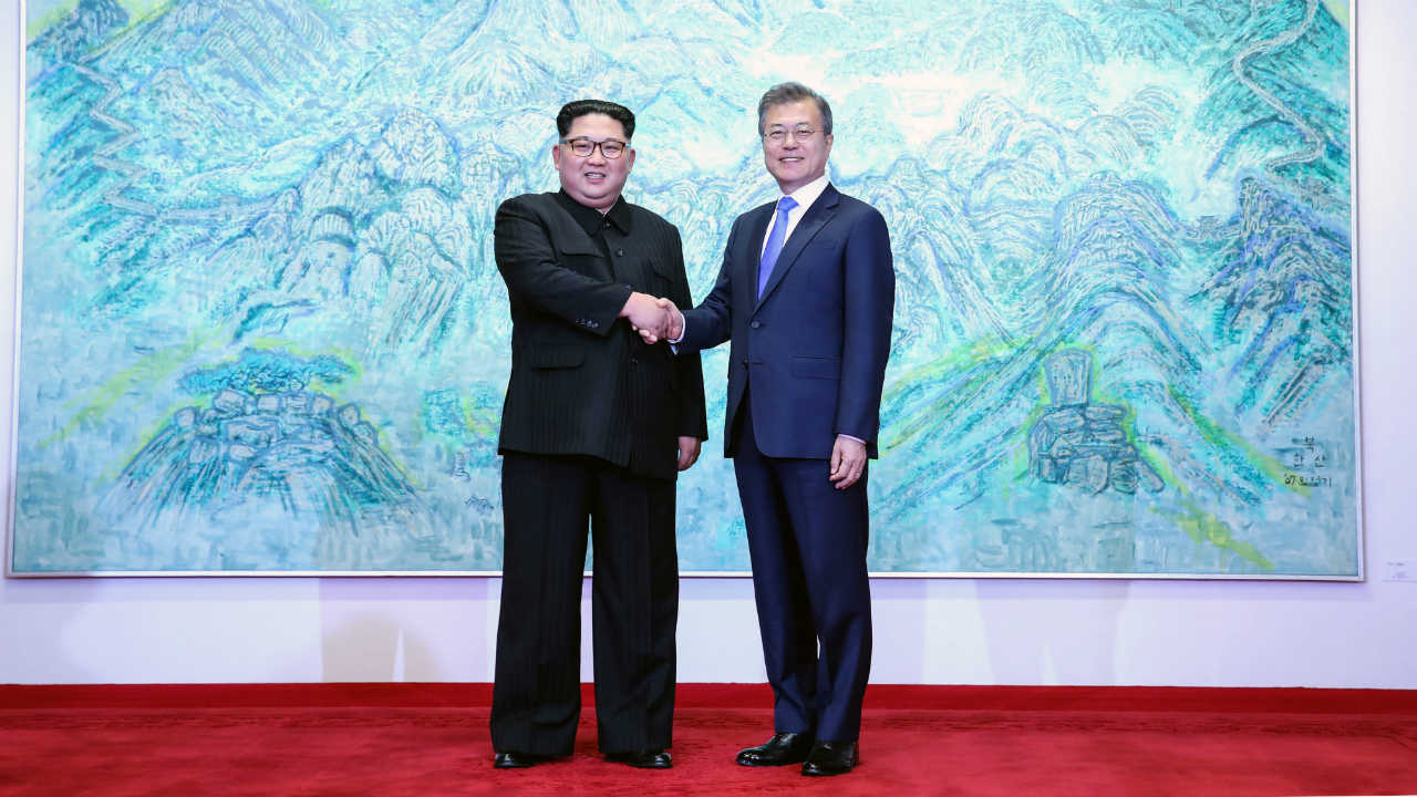 Moon and Kim greet each other during their meeting. (Image: Reuters)