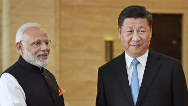 PM Narendra Modi meets Chinese Prez Xi Jinping, discusses ways to strenghten bilateral ties