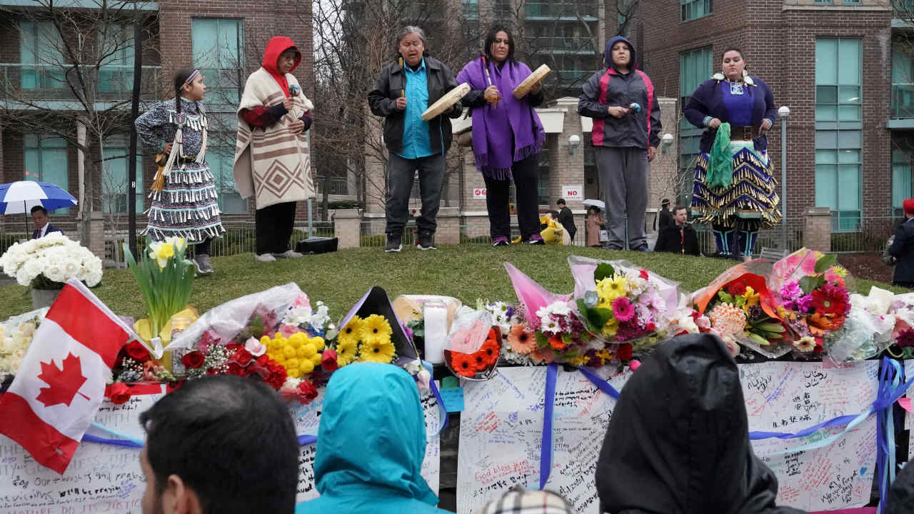Native leaders perform a traditional prayer at a makeshift memorial on Yonge Street following a van that attacked multiple people in Toronto, Ontario, Canada. (Reuters)