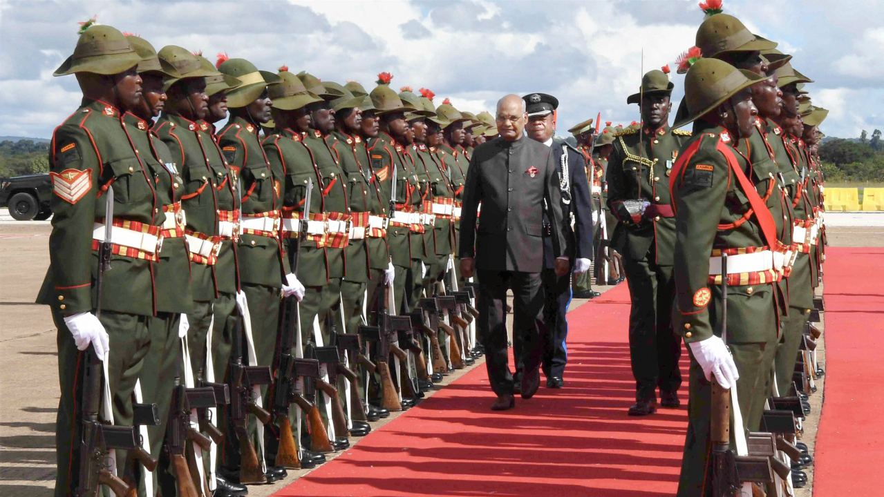 President Ram Nath Kovind inspects a guard of honour on his arrival at Kenneth Kaunda International Airport, Lusaka in Zambia. (Image: PTI)