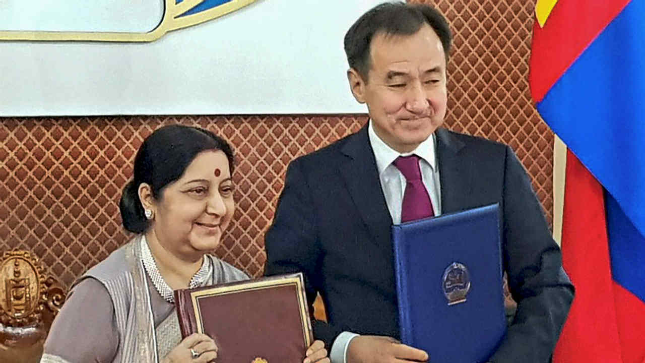 External Affairs Minister Sushma Swaraj and Mongolia Foreign Minister of Mongolia Damdin Tsogtbaatar pose for a picture during a signing ceremony during the 6th India-Mongolia Joint Committee meeting at Ulaanbaatar in Mongolia. (PTI)