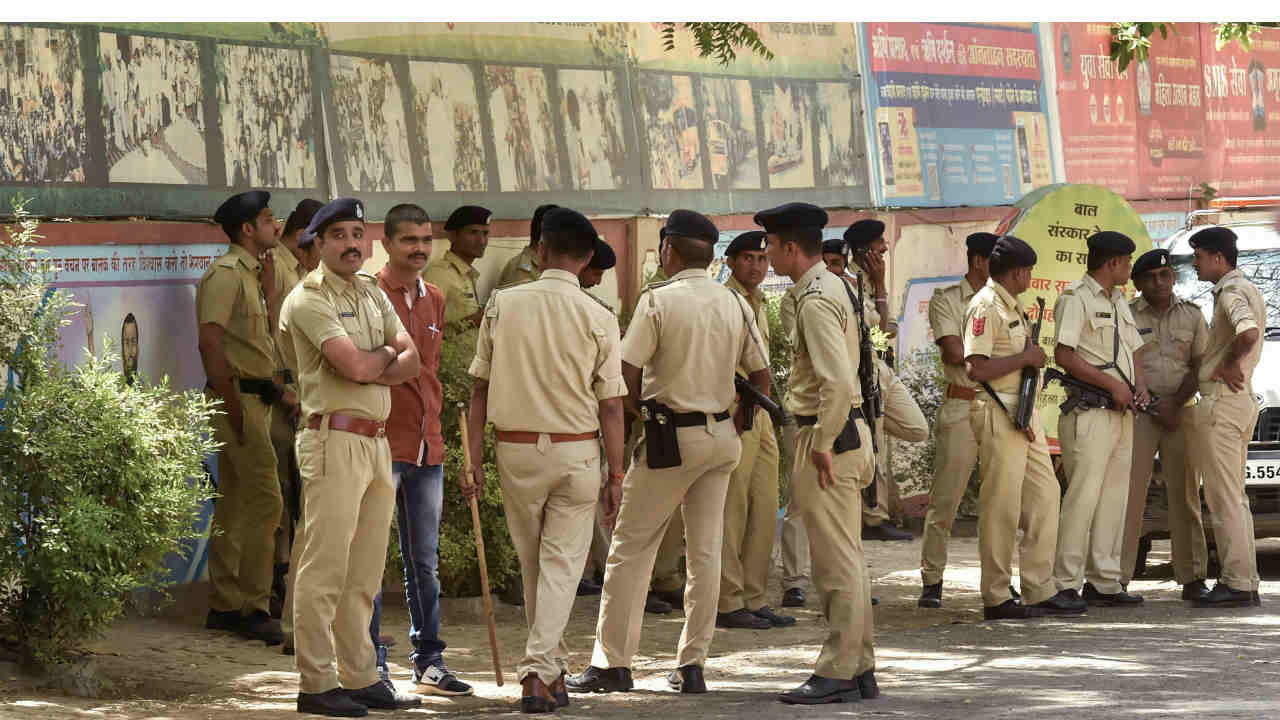 Gujarat police personnel deployed outside the ashram of self-styled godman Asaram after he was convicted in a special SC/ST court in Jodhpur for a 2013 rape case against him, in Ahmedabad. (PTI)