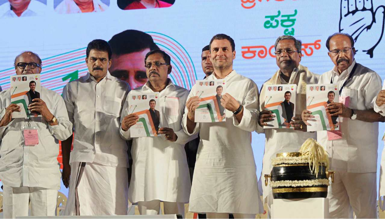Congress President Rahul Gandhi with party leaders releases the Congress manifesto for Karnataka Assembly Election 2018, in Mangaluru on Friday. (PTI)