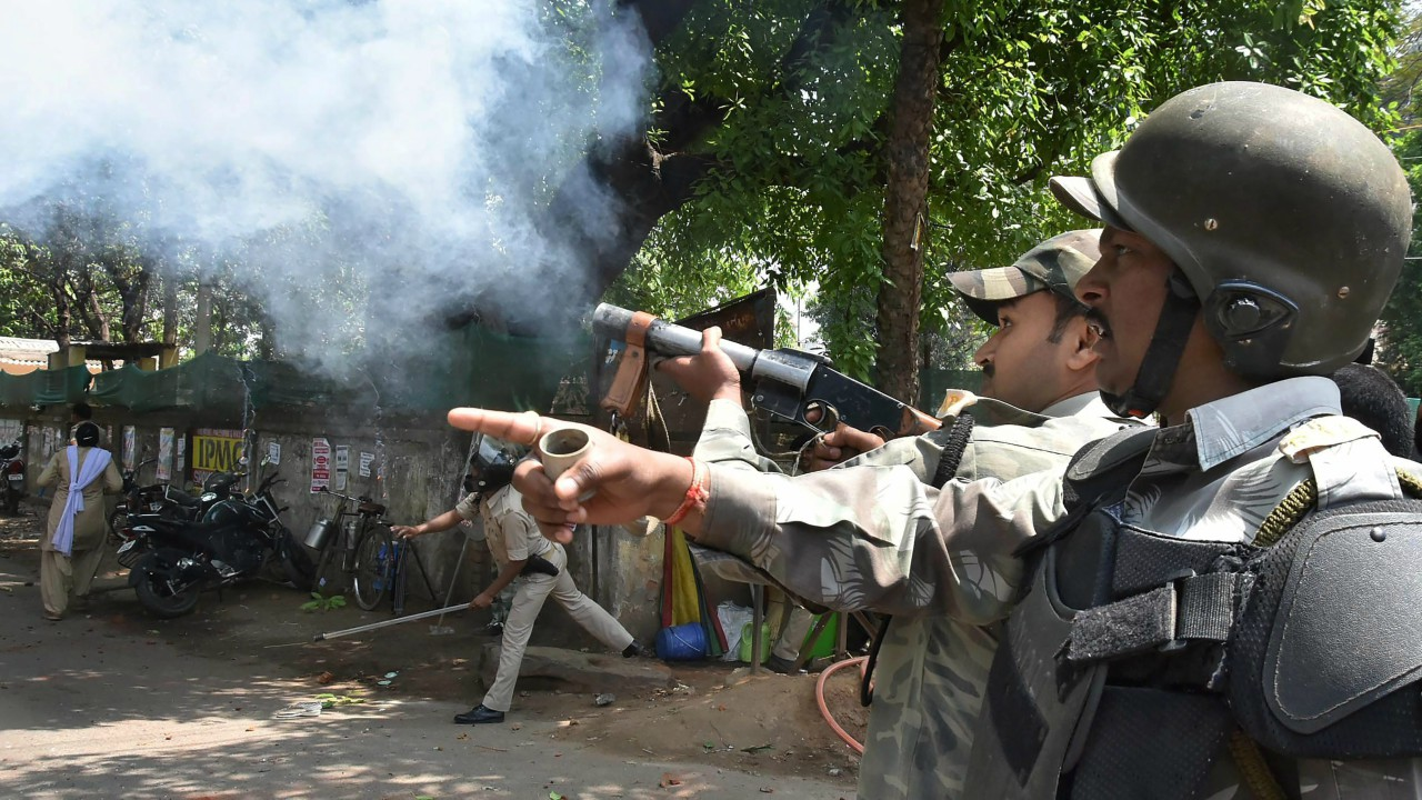 Police personnel fire tear gas shells to disperse the protestors during 'Bharat Bandh', call given by Dalit organisations against the alleged dilution of Scheduled Castes / Scheduled Tribes Act, in Ranchi. (PTI)