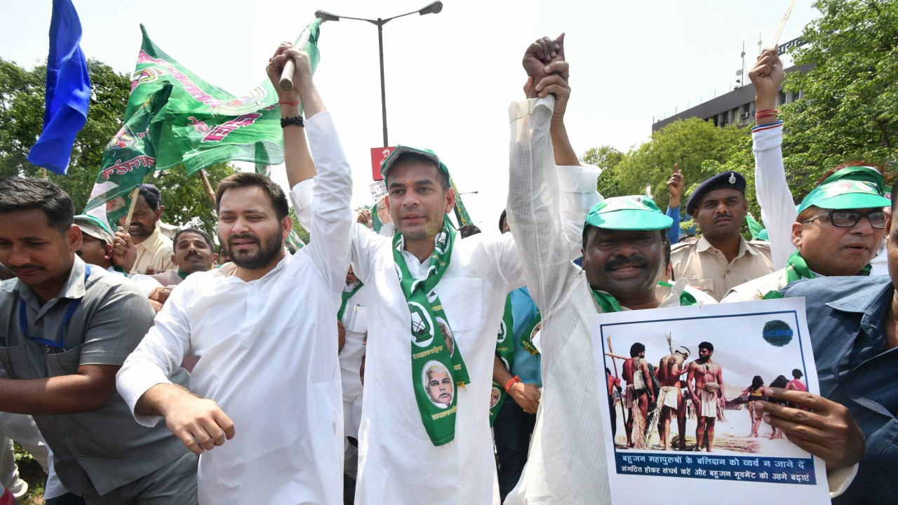 RJD leader of opposition Tejashwi Yadav with Tej Partap Yadav and other MLA's raise slogans during 'Bharat Bandh' call given by Dalit organisations against the alleged 'dilution' of the Scheduled Castes and Scheduled Tribes act, in Patna. (PTI)
